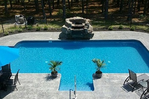Large pool with stone water feature
